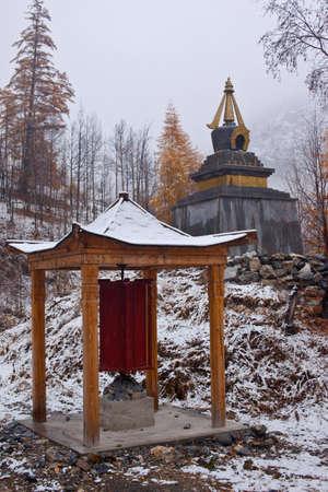 Photo of buddhists pavilion and stupa. Snowfall photo