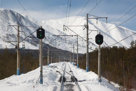 mainline: Railroad turnout with two traffic lights on the Baikal-Amur Mainline Stock Photo