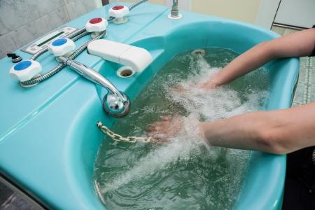 hydromassage: photo of woman taking hand bath with hydromassage Stock Photo