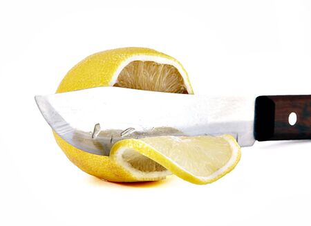 Knife a cutting juicy lemon on a white background