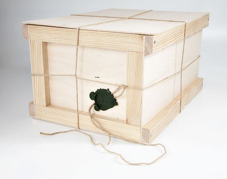 The wooden closed box on a white background Stock Photo