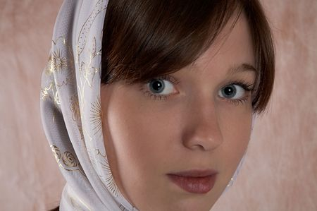 Portrait of the girl in a kerchief in an interior Stock Photo