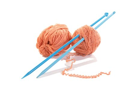 Knitting spokes with ball of wool on white background Stock Photo