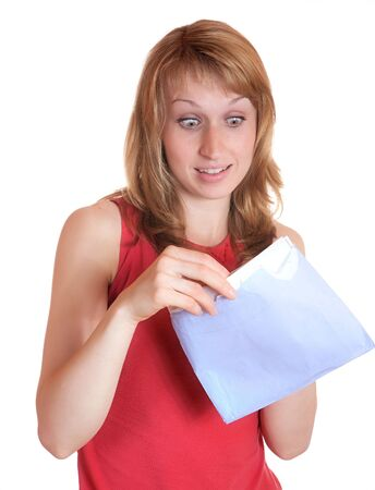 The girl with surprise opens  letter on a white background Stock Photo - 5040137