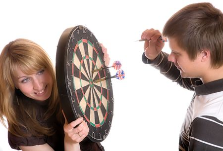 The young man and girl play a darts on white background