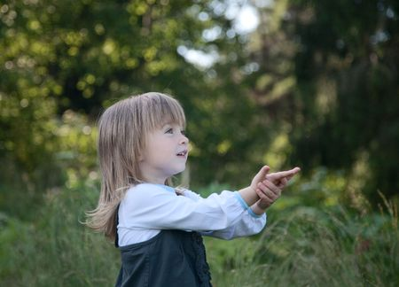 little girl on a background of green wood