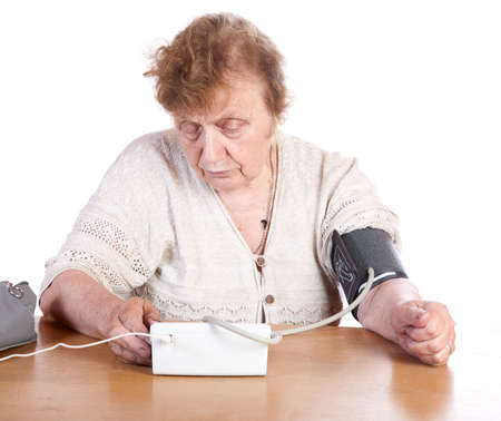 arterial: The old woman measures arterial pressure upon a white background
