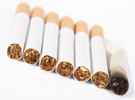 pernicious: Some the whole  and one not finished smoking cigarette lay in line Stock Photo