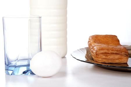 pasteurized: Milk an egg and  roll in a plate on table