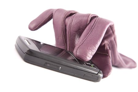 Female leather glove and cellular telephone on a white background photo