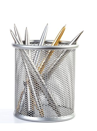 Metal ball-point pens in a support on white background photo