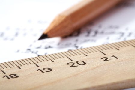 close quarters: wooden ruler and pencil lay on the drawing