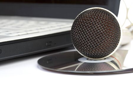 dubbing: The microphone lays on notebook near to compact discs