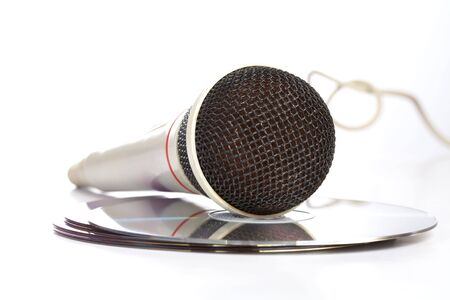 dubbing: The microphone lays on  compact discs on  white background Stock Photo