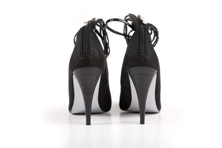 Woman black shoes on the white background