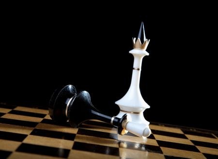 The white queen checkmate to black king on  black background Stock Photo - 6112202