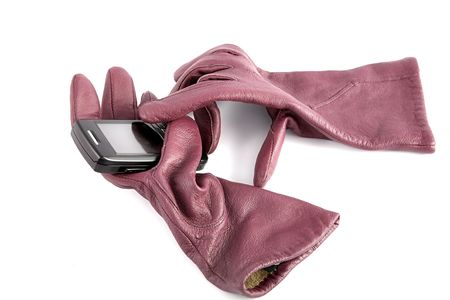 cellular telephone: Leather gloves compress cellular telephone on a white background Stock Photo