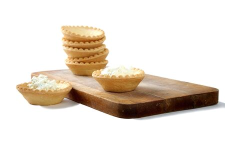 Tartlets with soft cheese isolated on a white background Stock Photo - 6341695