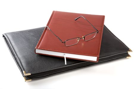 myopic: Folder for papers an organizer and glasses on a white background