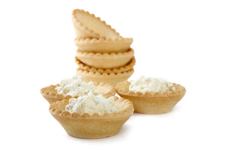 Tartlets with soft cheese isolated on a white background Stock Photo - 6787529