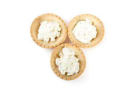 Tartlets with soft cheese isolated on a white background Stock Photo - 6787531
