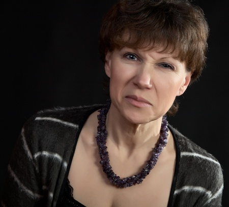 discontent: The woman with  discontent grimace on a black background Stock Photo