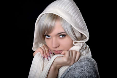 The girl in  white hood on a black background photo