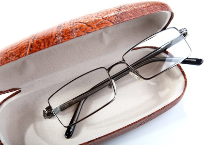 Pair of glasses in a case on a white background