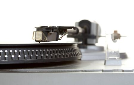 Old  player and vinyl phonograph record on a white background photo