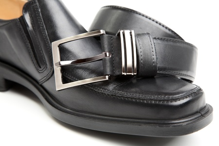 Mans boot and belt on a white background Stock Photo