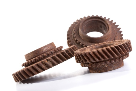 Rusty gears on a white background isolated photo
