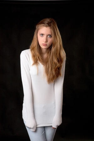 black sweater: The girl in  white sweater on a black background