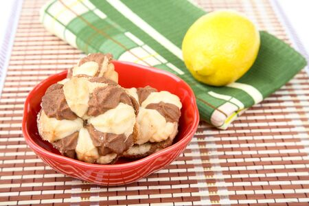 Plate with cookies lemon and  towel on a white background Stock Photo - 9959078