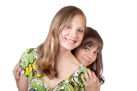 Two smiling girls isolated on a white background