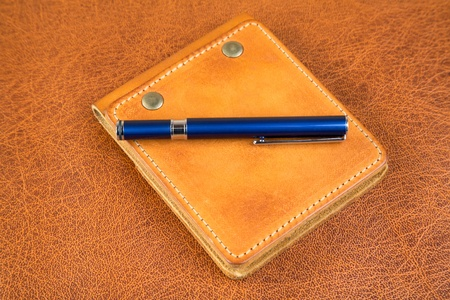Leather organizers and fountain pen on a textural background Stock Photo - 10927145