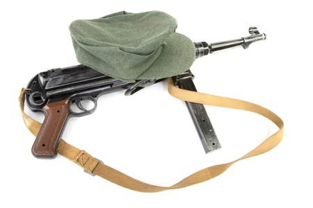 kepi: Germany in the Second World War. Composition with standard army field cap (kepi) and submachine gun MP40