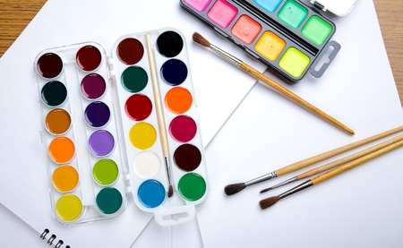 paintbox: Water colour paints  brush albums for drawing on a table