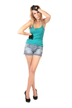 utmost: girl to the utmost in shorts and gloves isolated on a white background
