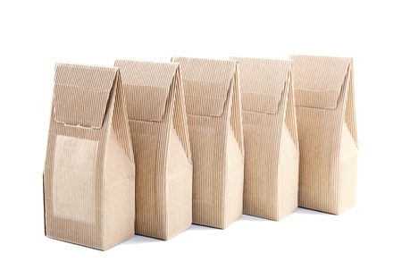 row of boxes from the goffered cardboard isolated on a white background