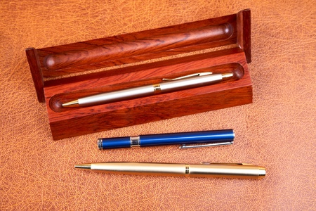 clericalist: Three pens on a textural background