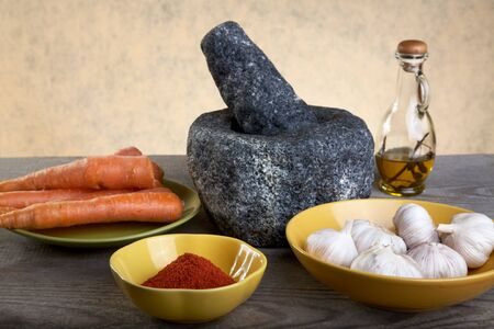 Stone mortar and spices on a wooden table Stock Photo - 13341238