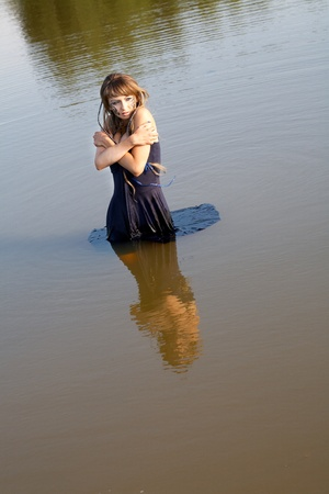 girl  a dress stand in lake  the summer evening photo