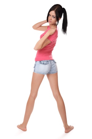 utmost: girl in shorts to the utmost on a white background