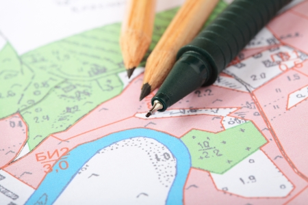 Topographic map with pencils and a RollerBall Stock Photo - 13817725