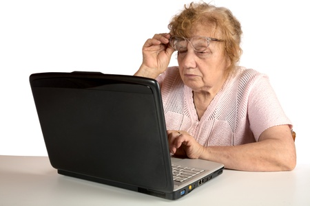 Granny with the laptop isolated on a white background photo