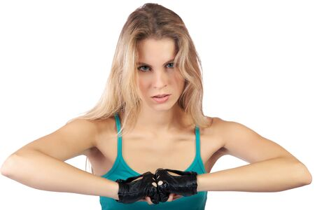 girl in a sports vest and gloves clenches fists on the white Stock Photo