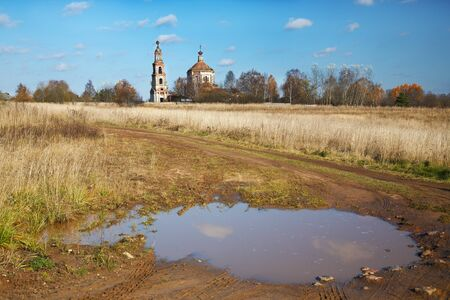 Rural landscape with the destroyed old church photo