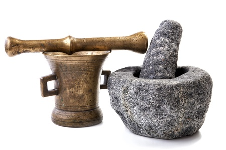 Granite and brass mortar with pestles on a white background photo