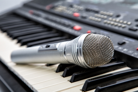 Microphone on keys of a musical synthesizer photo