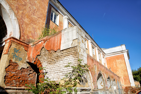 outworn: Old walls against the dark blue sky